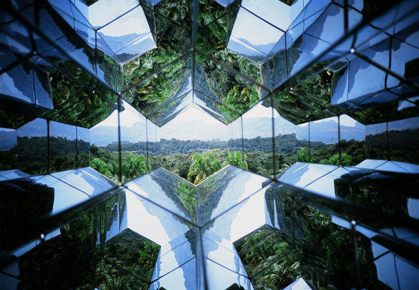 """Artist Olafur Eliasson's """"Viewing Machine,"""" a work of art in the shape of oversized outdoor kaleidoscope that visitors can use to look out on Inhotim, perhaps the world's largest open-air museum."""