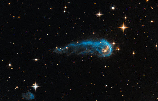 A light-year-long knot of interstellar gas and dust looks like a caterpillar but is, in fact, a star just starting to form.