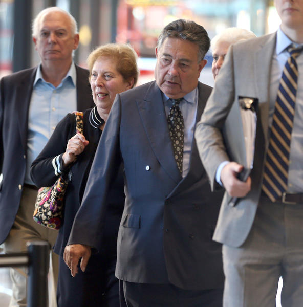 Lombard businessman Daniel Dvorkin, center, leaves the Dirksen U.S. Courthouse Thursday.