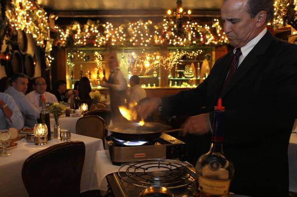 A dish of steak Diane is prepared tableside at Sabatinos in Chicago in this 2011 file photo.