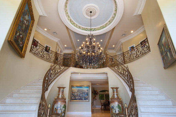 Brad Turell's home features a grand foyer with dual staircases and 35-foot-tall ceilings.
