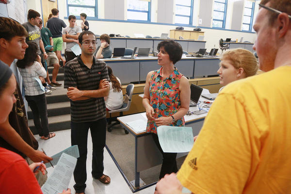 Julia Browne, center, director of Career Development at Connecticut College discusses a career assessment worksheet with freshmen. Incoming freshmen took part in a career development workshop as part of orientation week.