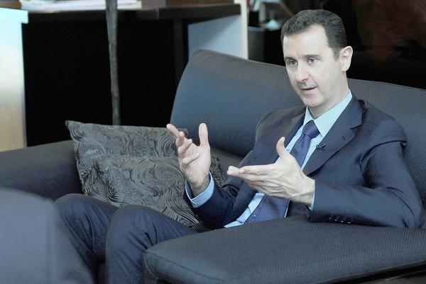 Syrian President Bashar Assad speaks during an interview with a Russian newspaper in Damascus on Monday.