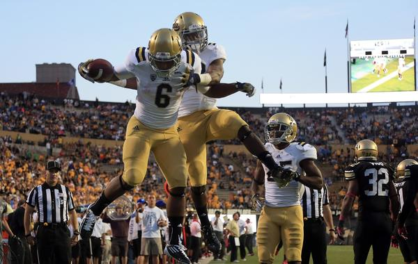 UCLA running back Jordon James, left, celebrates with teammate Jerry Rice Jr. following a touchdown against Colorado last season. The Bruins had a breakout season in 2012. Will they achieve more success in 2013?