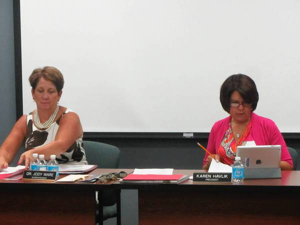 Mundelein Consolidated High School District 120 Superintendent Jody Ware (left) and board of education President Karen Havlik (right) discuss Adequate Yearly Progress scores.