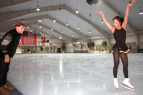 Michelle Kwan works on her choreography with Elena Tcherkasskaia at Ice Castle International Training Center in Lake Arrowhead, Calif. on March 11, 1996.