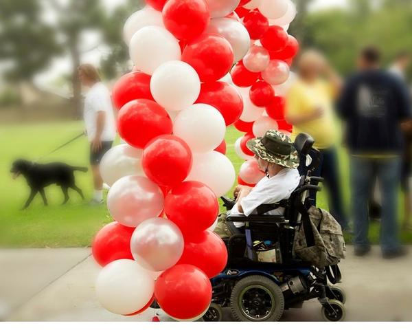 Scott Bradford of Costa Mesa goes through the balloon arch during the Aug. 24 Walk for Independence and Health Fair at TeWinkle Park. The event in Costa Mesa raised more than $20,000 for Project Independence, which aids people with disabilities.