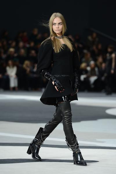 British model Cara Delevingne shows off a street tribe look for Chanel during the Fall/Winter 2013 Ready-to-Wear show as part of Paris Fashion Week at Grand Palais.