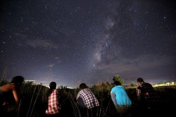 People watch the sky in Yangon.