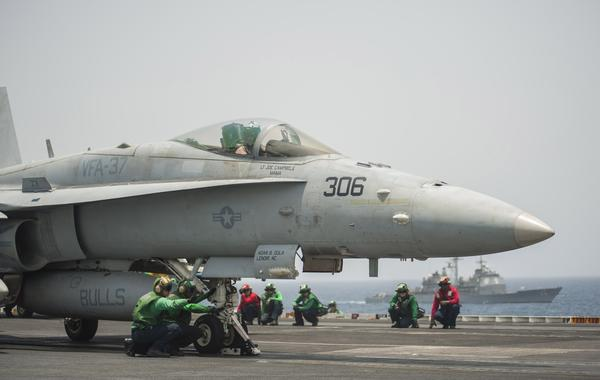 An F-18 Hornet is readied for launch aboard the USS Harry S. Truman in the Gulf of Aden on Aug. 22, 2013. The aircraft carrier is the flagship for the Harry S. Truman Carrier Strike Group.