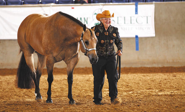 Nancy Replogle of Clear Spring shows her horse, Sweet Rosie O Grady, Aug. 27 at the 2013 Adequan Select American Quarter Horse Association World Championship Show in Amarillo, Texas. The two captured the reserve world championship title and the first-place Super-Select title in aged mares.