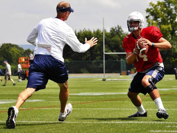 Penn State quarterback Christian Hackenberg practices drills with position coach Charlie Fisher. Hackenberg reportedly will start Saturday against Syracuse.