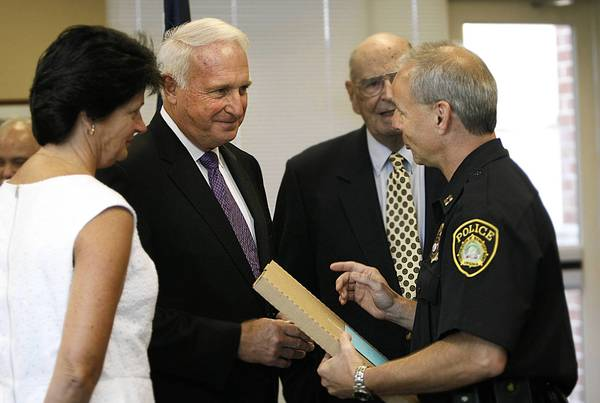 Newport News Police Chief James Fox receives a plaque from Captain Randy Franklin. On the left is Paula Fox and in the rear, Robert Perkins. Fox retires Sept. 1 after nine years at the helm of the department.