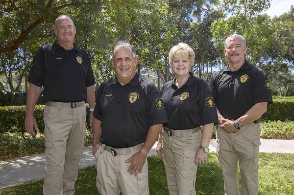 Jess Gilman, left, Joe Chirillo, Karen Borders and Mike Colver, all retired law enforcement personnel with Campus Safety Program, a company that provides specially-trained personnel for schools to augment their security measures.