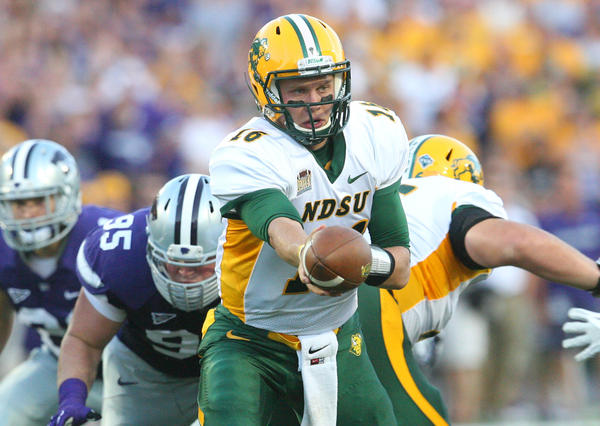 North Dakota State Bison quarterback Brock Jensen hands off the ball during first-half action against Kansas State. (USA Today Sports Photo)