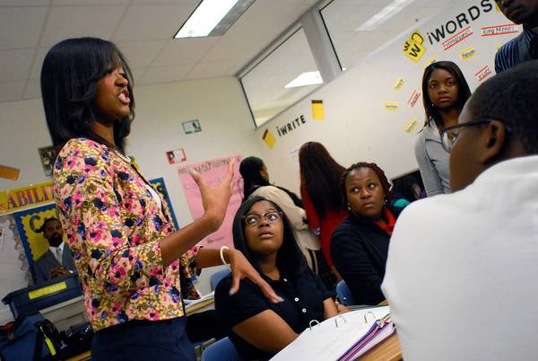 Teacher Shawonna Coleman, left, talks to her Atlanta high school students about the history of segregation in the U.S.