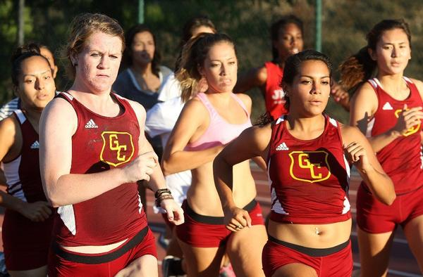 The Glendale Community College's women's cross country team works out during a practice on campus.