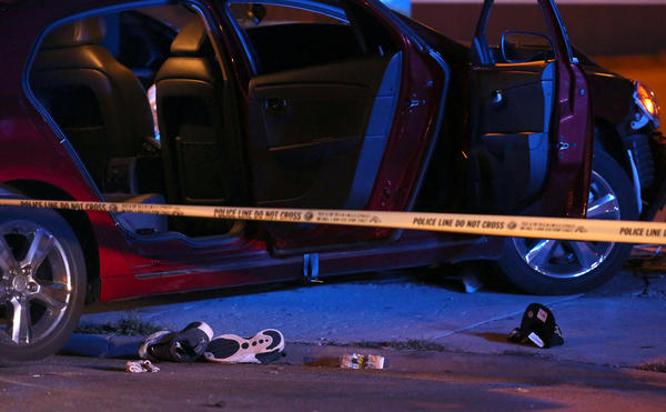 Chicago police secure a car where one man was found shot inside after crashing in the intersection of 43rd St. and Wentworth Ave., just west of the Dan Ryan Expressway. Police found the man shot in the head inside the car after police pursued the car from an earlier Bridgeport shooting.