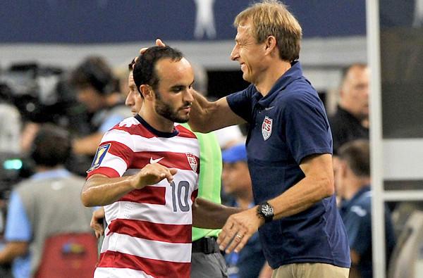 U.S. coach Juergen Klinsmann congratulates midfielder Landon Donovan after substituting for him in a 3-1 victory over Honduras earlier this summer.