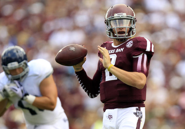 After serving a half-game suspension, Texas A&M quarterback Johnny Manziel threw for 94 yards and three touchdowns (6-for-8) in a 52-31 victory over Rice.