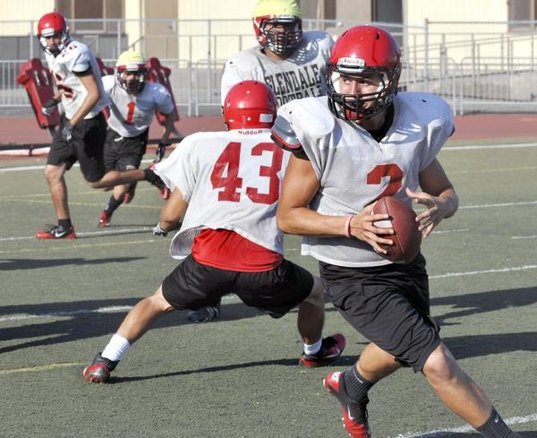 Glendale High quarterback Kevin Felix, right, returns for his senior season looking to lead the Nitros in 2013.