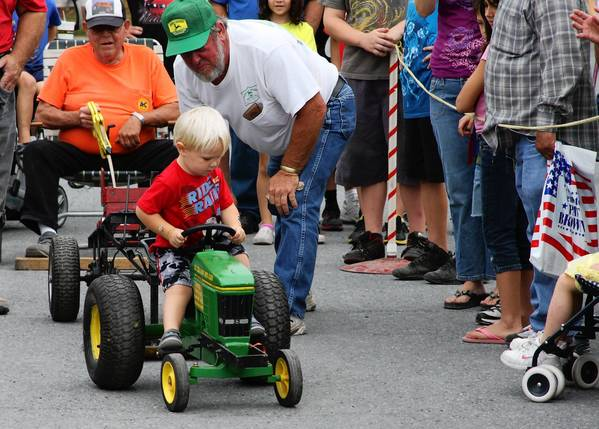 The Barnyard Olympics at the Allentown Fair Sunday features contests like tractor racing and cow mooing.