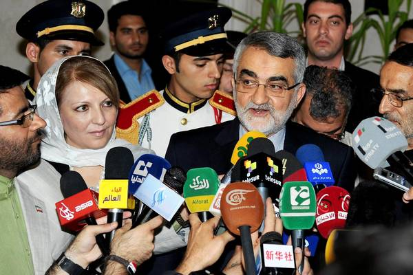 Alaeddin Boroujerdi, right, chairman of the Iranian Shura Council's Committee for Foreign Policy and National Security, speaks at a news conference Saturday after his meeting with Syria's speaker of the People's Assembly. Iran sent a senior parliamentary delegation to Damascus on Saturday for a five-day visit as a sign of solidarity with the Syrian government. The delegation will also meet with Syrian President Bashar Assad, the Syrian Arab News Agency reported.