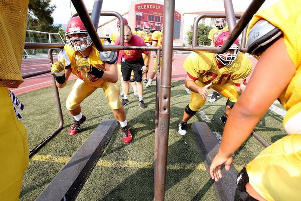 Lineman run offensive blocking drills during football practice at GCC on Monday. With only eight returners, the Vaqueros will be youthful in 2013. (Tim Berger/Staff Photographer)