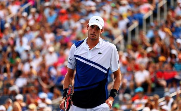 American John Isner lost to Germany's Philipp Kohlschreiber in the third round of the U.S. Open on Saturday.