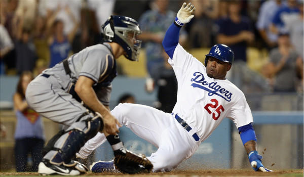 Four-time American League stolen-base champion Carl Crawford, shown sliding safely past San Diego catcher Nick Hundley on Friday, has only 13 for the Dodgers this season.