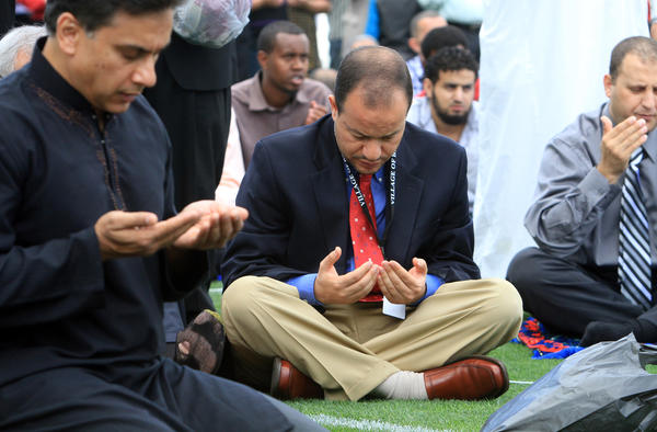 Dr. Zaher Sahloul chair of the Council of Islamic Organizations of Greater Chicago joins thousands of Muslims filled the infield at Toyota Park to observe the end of Ramadan at the Eid-ul-Fitr prayer service on Aug. 19, 2012 in Bridgeview.