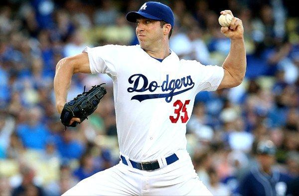Dodgers pitcher Chris Capuano, who went seven innings in his previous start against the Padres Saturday, couldn't make it out of the second inning against the Reds on Friday because of an injury.