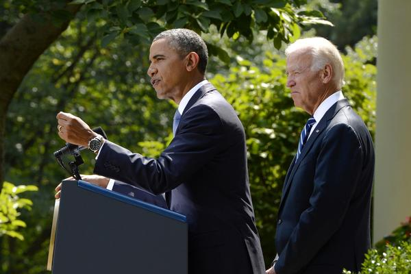 President Barack Obama (L) delivers remarks on the current situation in Syria and a US response, beside Vice President Joe Biden (R) in the Rose Garden of the White House Saturday.