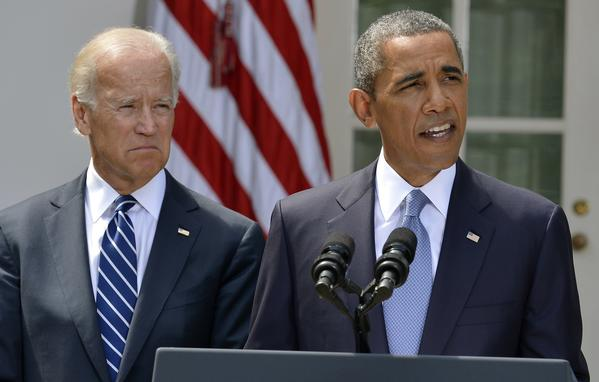 U.S. President Barack Obama speaks about Syria next to Vice President Joe Biden (L) at the Rose Garden of the White House August 31, 2013, in Washington. Obama said on Saturday he had decided the United States should strike Syrian government targets in response to a deadly chemical weapons attack, but said he would seek a congressional vote for any military action. REUTERS/Mike Theiler (UNITED STATES - Tags: POLITICS) ORG XMIT: WAS70