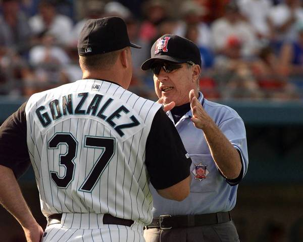 Florida Marlins Manager Freddi Gonzalez, left, listens to third base umpire Frank Pulli in 1999 during the game against the St. Louis Cardinals in Miami. Pulli used instant TV replay to retract a home run call. This was well before it was allowed to use instant replay for such purposes.