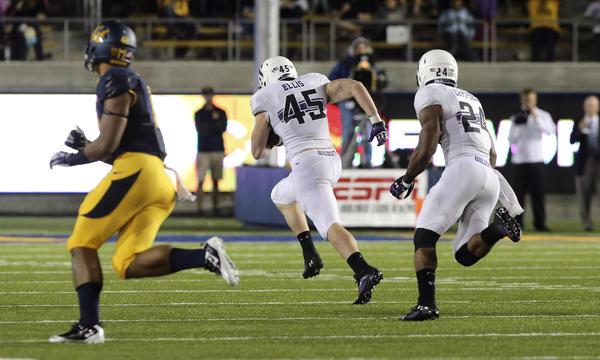 Northwestern linebacker Collin Ellis (45) returns an interception for a touchdown in the fourth quarter.