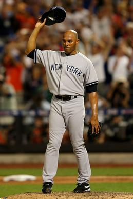 American League reliever Mariano Rivera acknowledges the crowd as he receives a standing ovation during the eighth inning of Tuesday's