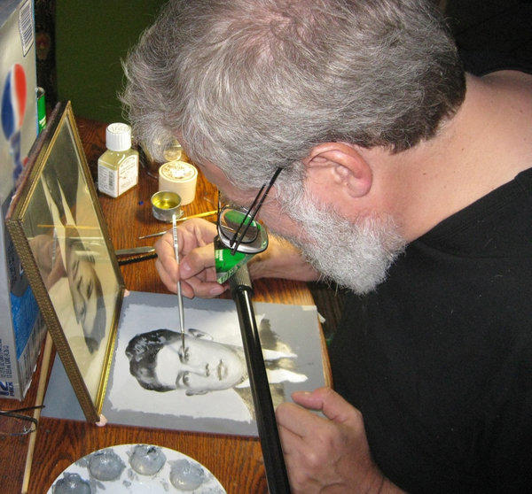 "Tim Jenison using his ""comparator mirror"" to paint a copy of a photograph in ""Tim's Vermeer."""