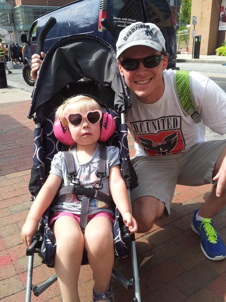Drew Williams, 28, of Manassas, Va. was at the race course on Friday with his daughter Zoe, who just turned 2 and was wearing bright pink, noise-canceling headphones in her stroller.