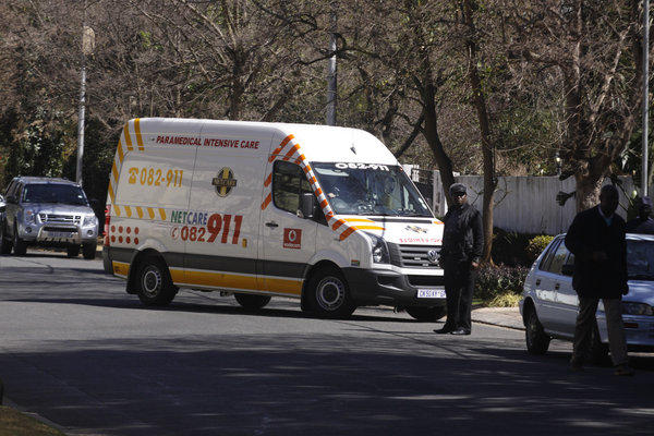 An ambulance carrying former South African president Nelson Mandela arrives at his home in Johannesburg, South Africa, on Sunday.