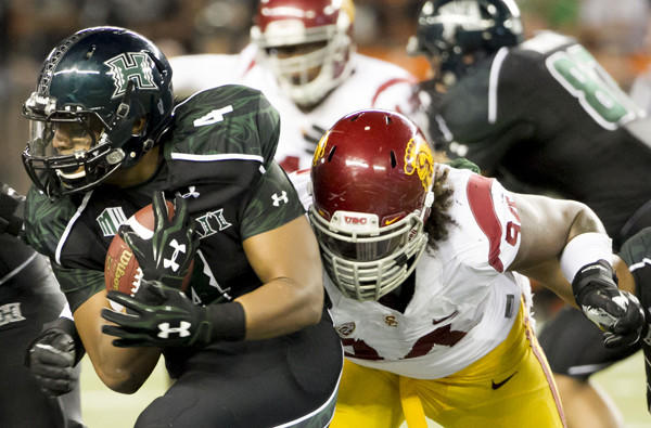 USC defensive end Leonard Williams brings down Hawaii running back Steven Lakalaka in the third quarter of their season-opening game on Thursday in Honolulu.