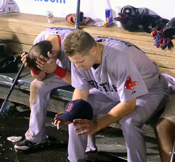 Jonathan Papelbon, right, and Marco Scutaro sit dejected after being eliminated from the playoff race with a season ending loss to the Orioles on Sept. 29, 2011. The Red Sox entered September with a nine-game lead in the Wild Card race.