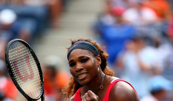 Serena Williams celebrates her fourth-round victory Sunday over Sloane Stephens at the U.S. Open