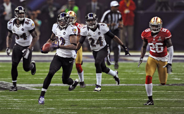 Jacoby Jones (#12) heads for the end zone on a record setting 108-yd kickoff return for a touchdown to open the second half of the Baltimore Ravens vs. the San Francisco 49ers in Super Bowl XLVII at the Mercedes-Benz Superdome.