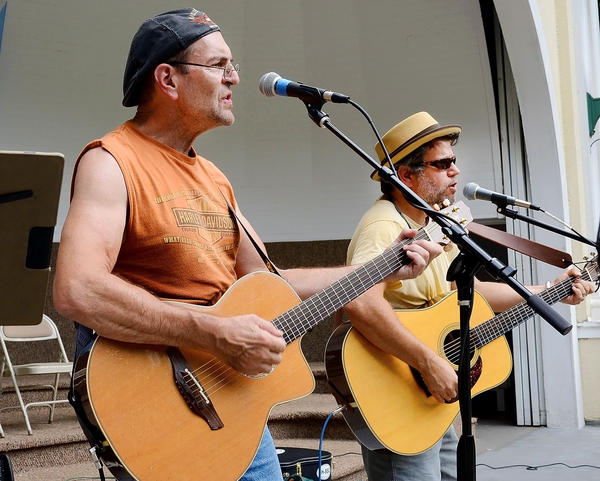 Jeff Kercheval, left, and Brian Keith perform Sunday at Hagerstown's City Park band shell as part of the Arts in the Park summer Sunday series.