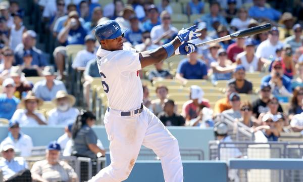 Dodgers outfielder Yasiel Puig hits a solo home run during the sixth inning of the Dodgers' 2-1 victory over the San Diego Padres on Sunday.