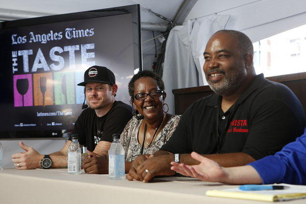 Ryan Chester of Smoqued BBQ, Sylvie Curry of the Lady of Q barbecue competition team and Neil Strawder of Bigmista's Barbecue discuss techniques.
