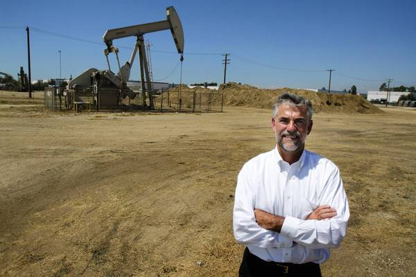 "BreitBurn co-founder Hal Washburn near a Santa Fe Springs cricket. ""We don't explore for new wells,"" he says."