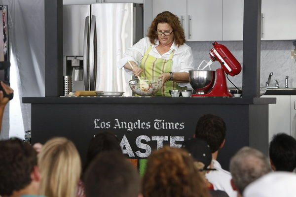 Chef Evan Kleiman mixes up food for her cooking demo.