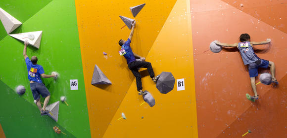 Roumania's Victor Dragoi (L), Ecuador's Andres Quinteros (C) and Japan's Shinta Ozawa compete in the men's qualifying round of the indoor World Climbing Championships 2012